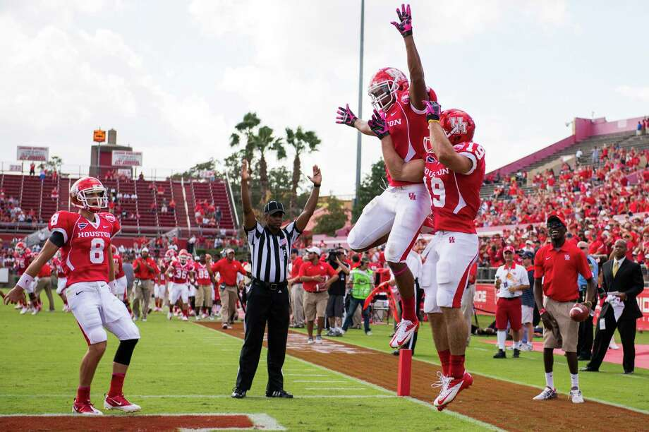 UH's Shane Ros, right, is joined by Charles Sims to celebrate Ros' first      career touchdown reception on a 25-yard pass from David Piland (8) during      the first quarter Saturday against UAB. Photo: Smiley N. Pool, Houston Chronicle / © 2012  Houston Chronicle