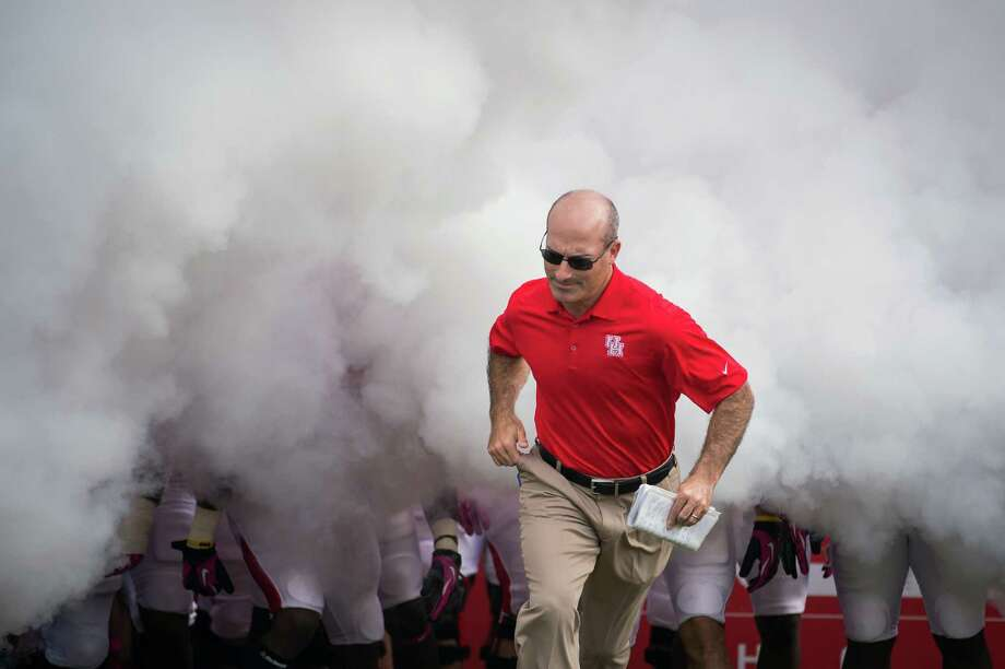 Houston head coach Tony Levine leads his team onto the field before a college football game against UAB at Robertson Stadium, Saturday, Oct. 13, 2012, in Houston. Photo: Smiley N. Pool, Houston Chronicle / © 2012  Houston Chronicle