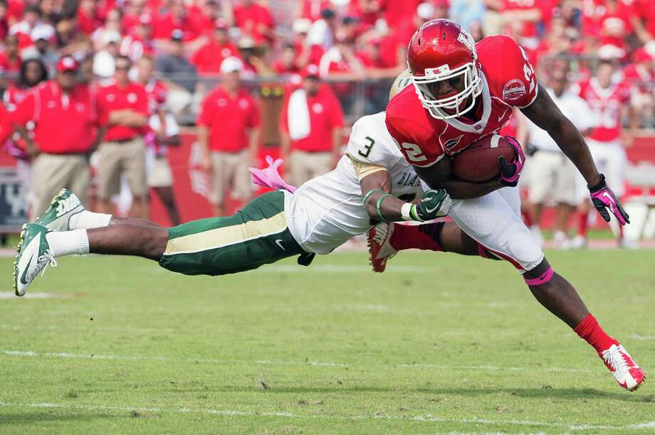UH 39, UAB 17Houston running back Ryan Jackson (22) is brought down by UAB safety Lamarcus Farmer (3) during the first half of a college football game at Robertson Stadium, Saturday, Oct. 13, 2012, in Houston. Photo: Smiley N. Pool, Houston Chronicle / © 2012  Houston Chronicle
