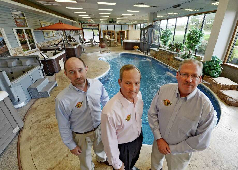 Jeff Kaufer, Spa Manager, left; Michael Giovanone, president and Richard A. Fenwick, vice president, left celebrate the 40th anniversary of Concord Pools and Spas in Latham, N.Y. Oct. 12, 2012.      (Skip Dickstein/Times Union) Photo: Skip Dickstein / 00019641A