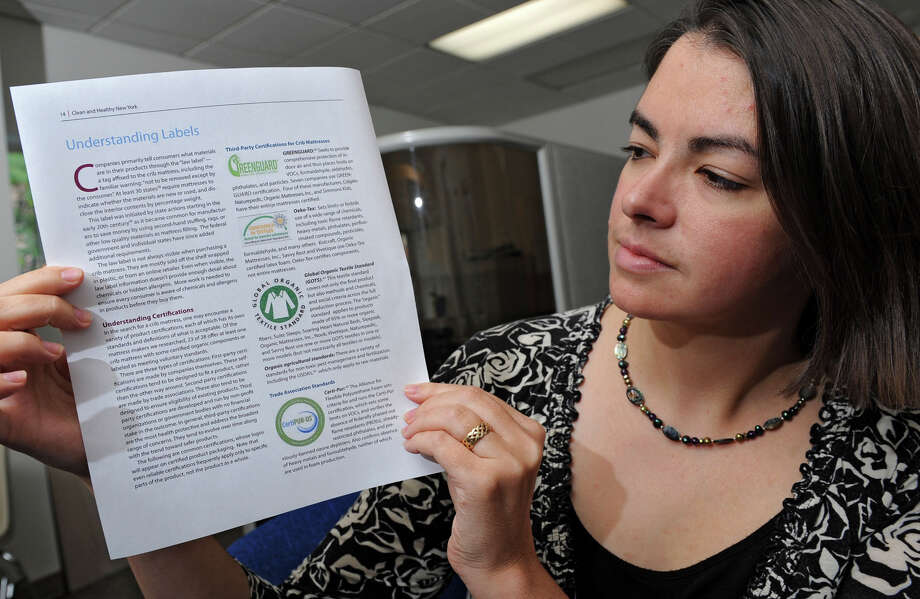 "Bobbi Chase Wilding of Clean and Healthy NY holds a print out of understanding labels and certifications at her office Thursday, Oct. 11, 2012 in Albany, N.Y.  Bobbi did a study last year about how infant mattresses were making a lot of misleading ""green"" claims. (Lori Van Buren / Times Union) Photo: Lori Van Buren"