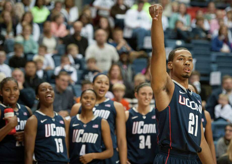 UConn's Omar Calhoun follows through on a shot during the 3-point competition against the women at the men's and women's basketball teams' First Night event in Storrs on Friday. While Calhoun, a guard, has looked every bit like a top recruit, UConn's young frontcourt looks a little thin and will face many challenges this season. Photo: Jessica Hill, Associated Press / FR125654 AP