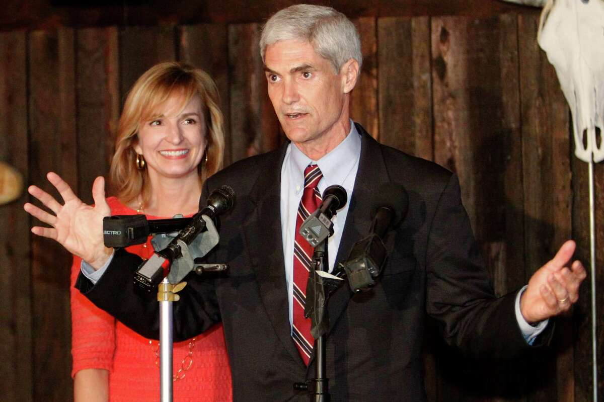 Republican candidate for Harris County District Attorney Mike Anderson gives his victory speech with his wife Devon Anderson at his election watch party at Blanco's Bar & Grill Tuesday, May 29, 2012, in Houston. ( James Nielsen / Chronicle )