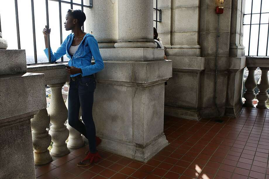 Freshman Gift Betty Opar of Kenya checks out the Campanile tower, above, on the UC Berkeley campus. Photo: Liz Hafalia, The Chronicle