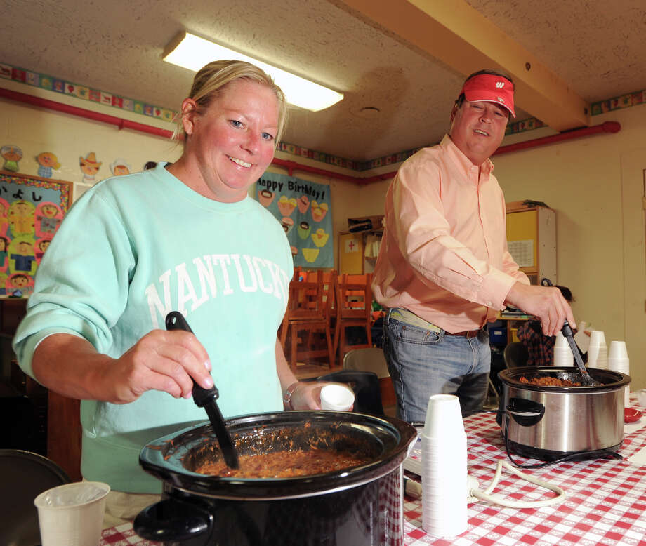 Patty Kochan, left, and her husband, Thaddeus, stir their chili during the Cos Cob Chili Cook-Off to benefit the Neighbor to Neighbor food bank at Diamond Hill United Methodist Church in Cos Cob, Saturday afternoon, Oct. 13, 2012. Patty said she was competing against her husband with a roasted hand-pulled beef chili. Thaddeus said all the peppers in his recipe are from his Cos Cob garden. Photo: Bob Luckey / Greenwich Time