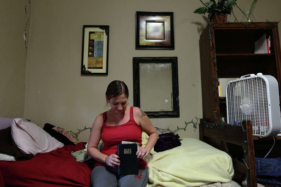 Jennifer Keith, who has bipolar disorder, moved into Evolution House two months ago and pays for the room she shares with two other women with her monthly disability check. Photo: Kin Man Hui, San Antonio Express-News / ©2012 San Antonio Express-News