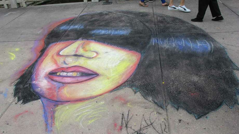 The work of Mark Aguilar at Chalk It Up on Saturday. Photo: Benjamin Olivo/mySA.com