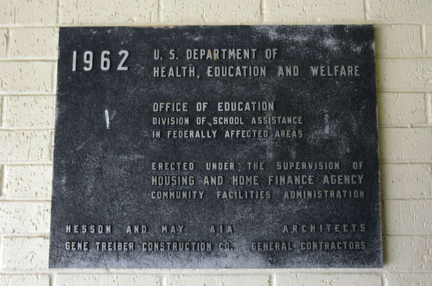 A historical plaque on the wall of Randolph High School marks the date of when the school and the district came into existence. The school district is facing budget cuts to their Impact Aid funding come January. In light of the cuts, Randolph has cut several athletic programs along with some staff reductions. The independent school district has about 1,200 students from pre-Kindergarten to High School and is celebrating their 50th year in education. Photo: Kin Man Hui, San Antonio Express-News / © 2012 San Antonio Express-News