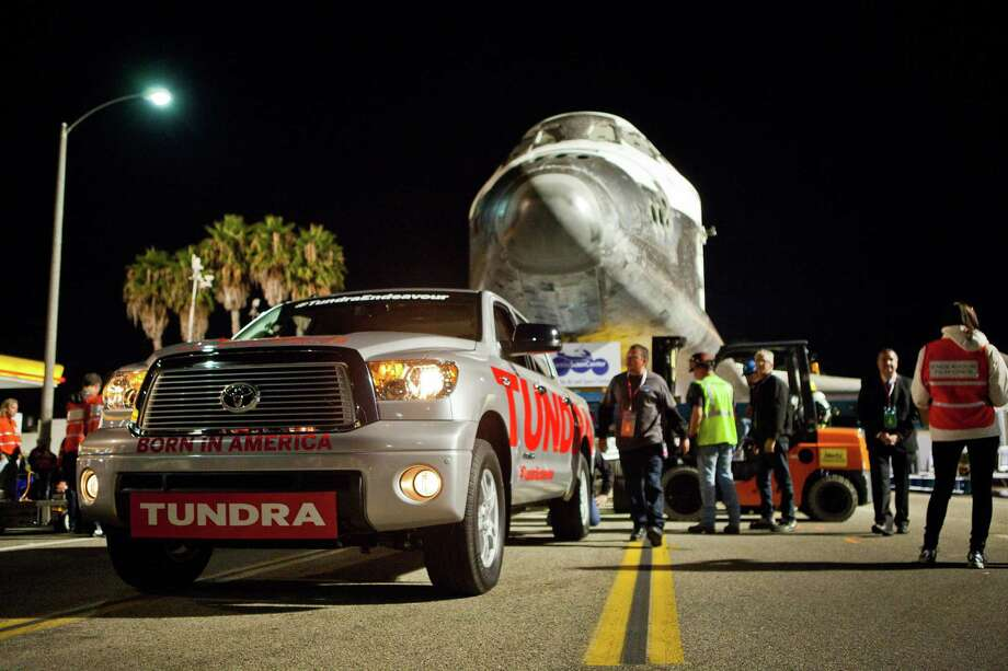 A San Antonio-built Toyota Tundra half-ton pickup truck without any special modifications tows the 150,000 pound space shuttle Endeavour across the Manchester Boulevard Bridge spanning the 405 freeway in Los Angeles, Friday night, Oct. 12, 2012. Photo: Courtesy Photo / Toyota