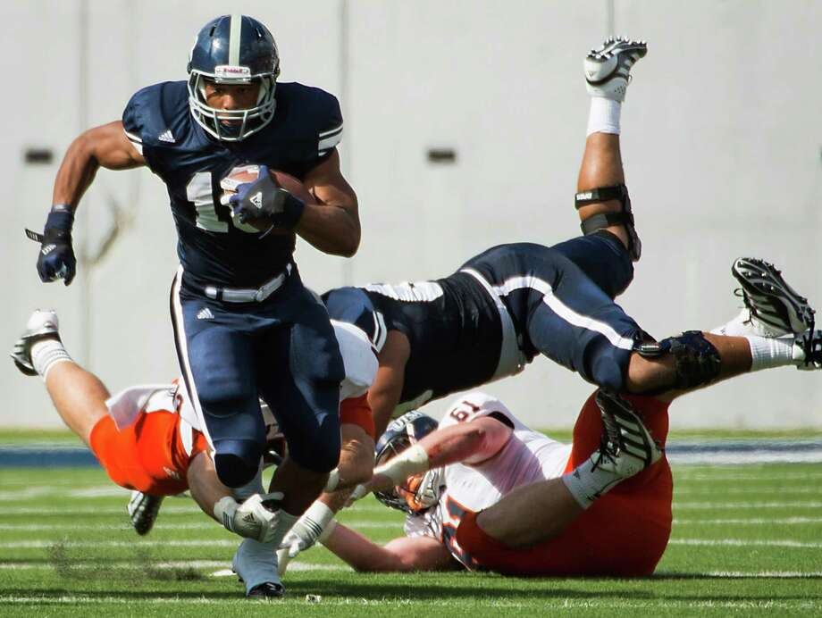 Rice running back Brandon Hamilton (18) breaks free for a long gain against UTSA during the first quarter of a college football game at Rice Stadium, Saturday, Oct. 13, 2012, in Houston. Photo: Smiley N. Pool, Houston Chronicle / © 2012  Houston Chronicle