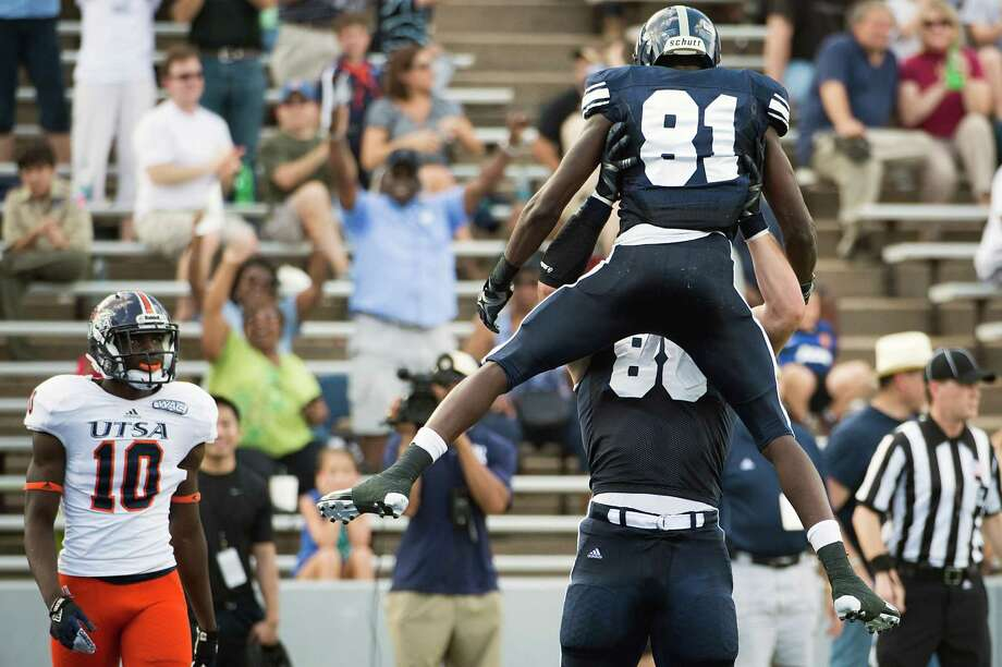 Rice 34, UTSA 14Rice wide receiver Donte Moore (81) celebrates a touchdown with wide receiver Vance McDonald (88) as UTSA safety Brian King (10) looks on during the first half of a college football game at Rice Stadium, Saturday, Oct. 13, 2012, in Houston. Photo: Smiley N. Pool, Houston Chronicle / © 2012  Houston Chronicle