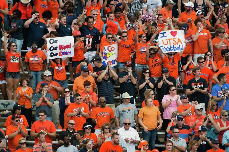 UTSA fans cheer as their team takes the field  before a college football game against Rice at Rice Stadium, Saturday, Oct. 13, 2012, in Houston. Photo: Smiley N. Pool, Houston Chronicle / © 2012  Houston Chronicle