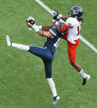 Rice cornerback Phillip Gaines (15) breaks up a pass intended for UTSA wide receiver Earon Holmes (12) during the first quarter of a college football game at Rice Stadium, Saturday, Oct. 13, 2012, in Houston. Photo: Smiley N. Pool, Houston Chronicle / © 2012  Houston Chronicle