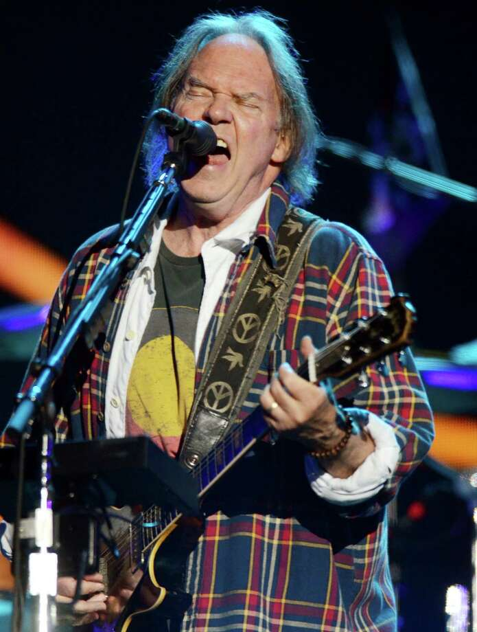 Legendary rocker Neil Young closed the second day of the Austin City Limits Music Festival at Zilker Park. Photo: Evan Agostini, Associated Press File Photo / Invision2012