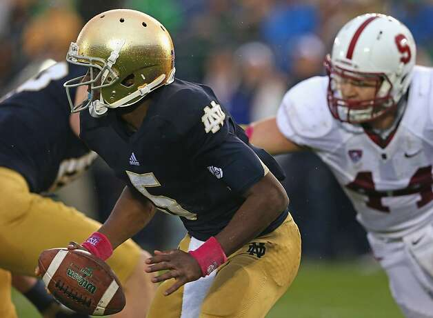 SOUTH BEND, IN - OCTOBER 13: Everett Golson #5 of the Notre Dame Fighting Irish tries to avoid the rush by Chase Thomas #44 of the Standford Cardinal at Notre Dame Stadium on October 13, 2012 in South Bend, Indiana.  (Photo by Jonathan Daniel/Getty Images) Photo: Jonathan Daniel, Getty Images
