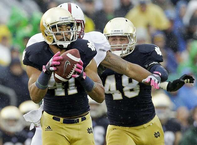 Notre Dame safety Matthias Farley (41) intercepts a pass past Stanford tight end Levine Toliolo (11) during the first half of an NCAA college football game in South Bend, Ind., Saturday, Oct. 13, 2012. (AP Photo/Nam Y. Huh) Photo: Nam Y. Huh, Associated Press