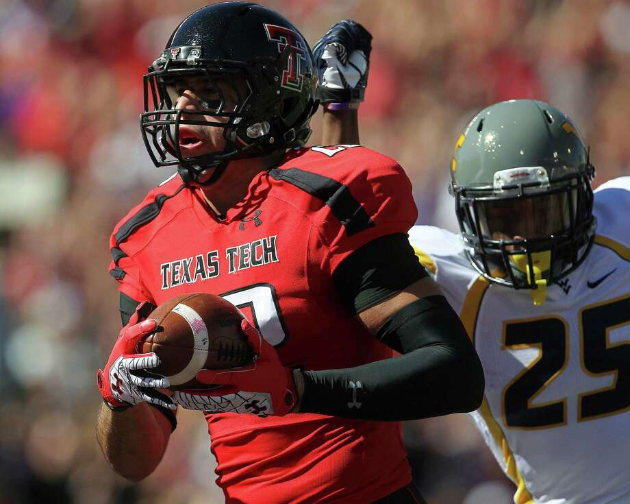 Texas Tech's Jace Amaro catches a pass for a touchdown ahead of West Virginia's Darwin Cook  during an NCAA college football game in Lubbock, Texas, Saturday, Oct. 13, 2012. (AP Photo/Lubbock Avalanche-Journal, Stephen Spillman) LOCAL TV OUT Photo: Stephen Spillman, Associated Press / Lubbock Avalanche-Journal