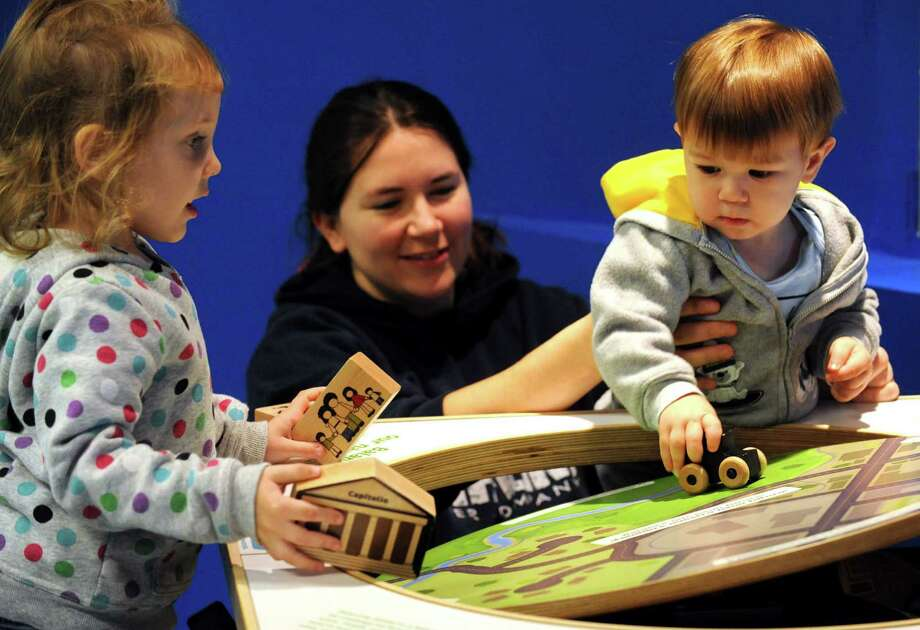 Three-year-old Cheyanne Downs, left, and Heather Moffitt with her 1-year-old son, Connor Moffitt, all of Cohoes play in the nano exhibit during the grand re-opening of the Children's Museum of Science and Technology in North Greenbush, NY Saturday Oct. 13, 2012. (Michael P. Farrell/Times Union) Photo: Michael P. Farrell