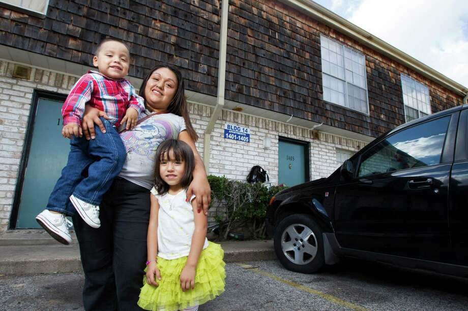 Rosa Rosario and her children - Jessica, 4, and Carlos, 2 - live in an apartment in Gulfton, an area that serves as a gateway to immigrants in Houston. Photo: J. Patric Schneider / © 2012 Houston Chronicle