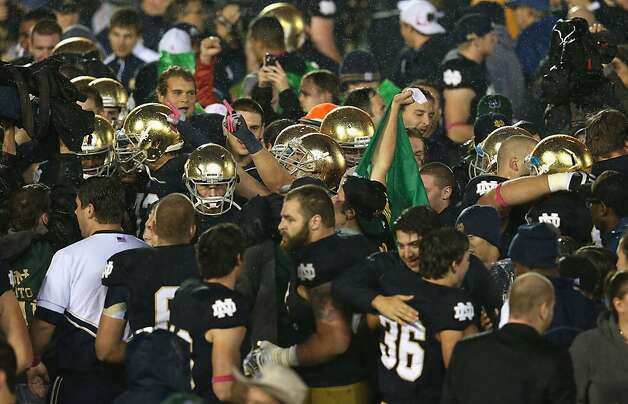 SOUTH BEND, IN - OCTOBER 13: Players and fans of the Notre Dame Fighting Irish celebrate a win over the Stanford Cardinal at Notre Dame Stadium on October 13, 2012 in South Bend, Indiana. Notre Dame defeated Stanford 20-13 in overtime. (Photo by Jonathan Daniel/Getty Images) Photo: Jonathan Daniel, Getty Images