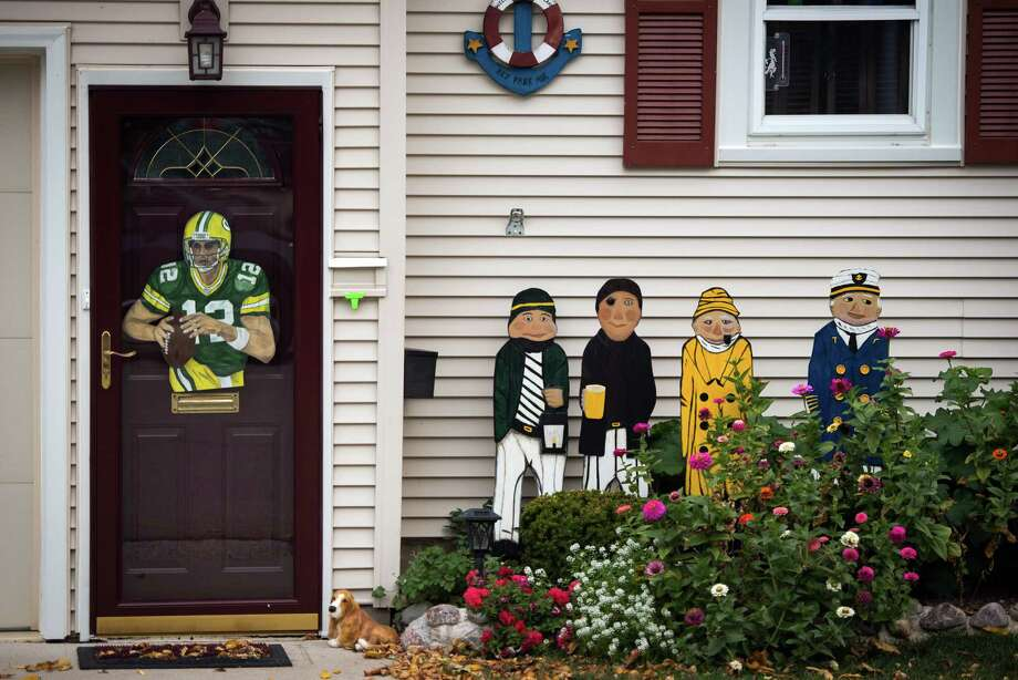 The likeness of Green Bay Packers quarterback Aaron Rodgers displayed on the front door of a home is one of the many signs of the loyalty to the NFL team in Pewaukee,Wis., hometown of Houston Texans defensive end J.J. Watt. Photo: Smiley N. Pool, Houston Chronicle / © 2012  Houston Chronicle