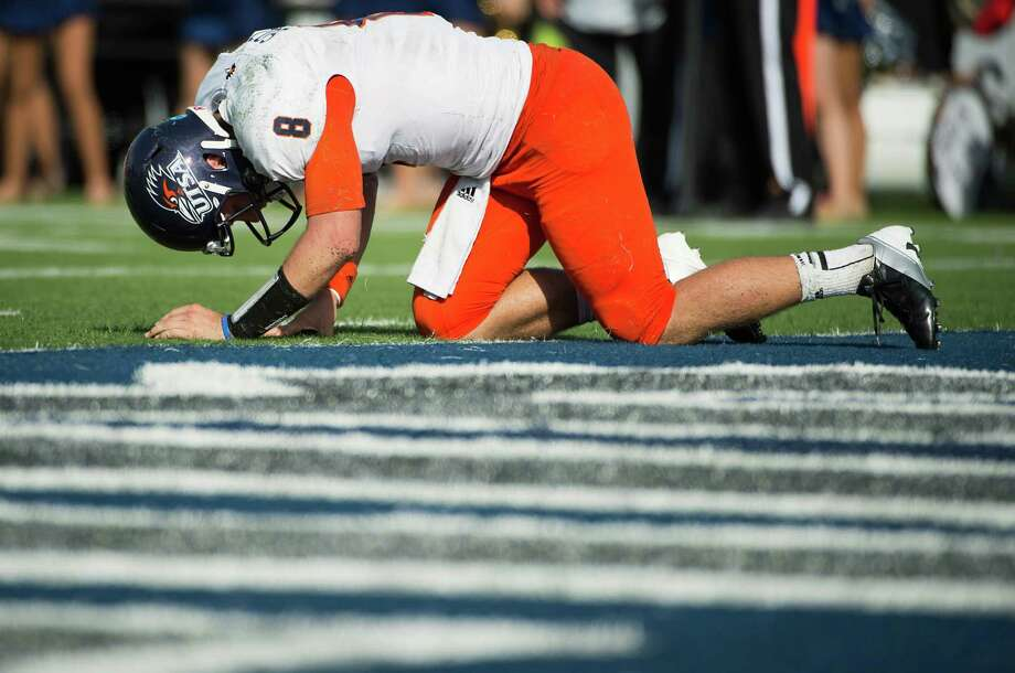 UTSA quarterback Eric Soza is slow to get up after taking a hit from the Rice defense during the second quarter of a college football game at Rice Stadium, Saturday, Oct. 13, 2012, in Houston. A roughing the passer penalty was called on the play. Photo: Smiley N. Pool, Houston Chronicle / © 2012  Houston Chronicle