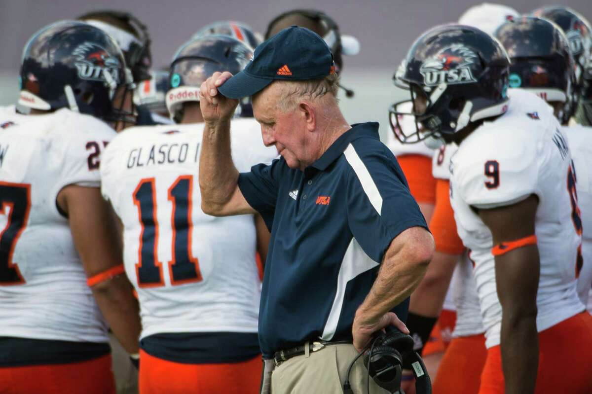 UTSA head coach Larry Coker adjusts his cap after a penalty against his team during the first half of a college football game against Rice at Rice Stadium, Saturday, Oct. 13, 2012, in Houston.