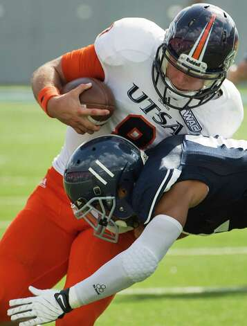 UTSA quarterback Eric Soza (8) is brought down by Rice safety Malcolm Hill (11) during the first quarter at Rice Stadium, Saturday, Oct. 13, 2012, in Houston. Photo: Smiley N. Pool, Houston Chronicle / © 2012  Houston Chronicle
