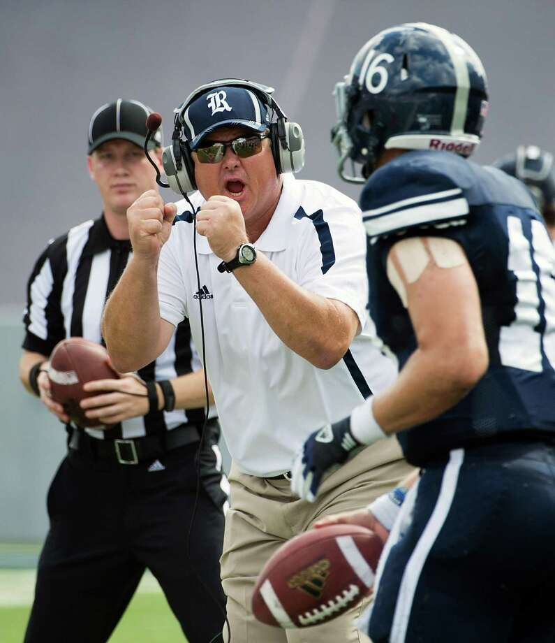 Rice head coach David Bailiff cheers a first down scramble by quarterback Taylor McHargue (16) during the first quarter of a college football game against UTSA at Rice Stadium, Saturday, Oct. 13, 2012, in Houston. Photo: Smiley N. Pool, Houston Chronicle / © 2012  Houston Chronicle