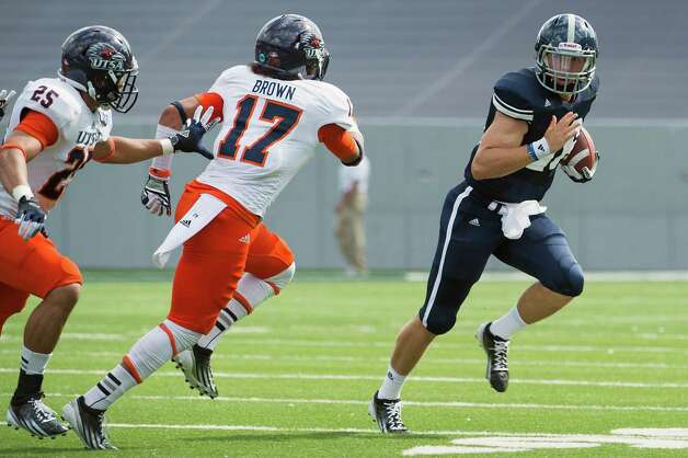 Rice quarterback Taylor McHargue (16) scrambles around UTSA cornerback Erik Brown (17) during the first quarter of a college football game at Rice Stadium, Saturday, Oct. 13, 2012, in Houston. Photo: Smiley N. Pool, Houston Chronicle / © 2012  Houston Chronicle
