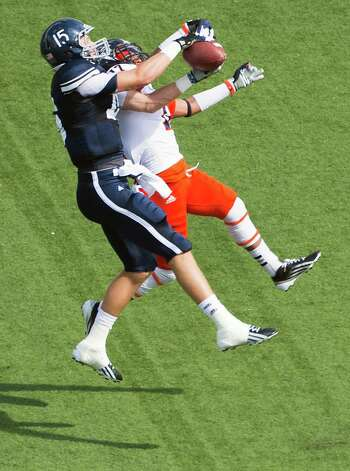 Rice wide receiver Jordan Taylor (15) makes a catch over UTSA cornerback Erik Brown (17) during the first quarter of a college football game at Rice Stadium, Saturday, Oct. 13, 2012, in Houston. Photo: Smiley N. Pool, Houston Chronicle / © 2012  Houston Chronicle
