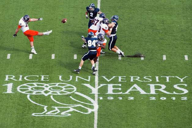 Over a logo celebrating the Rice University centennial, UTSA punter Josh Ward (47) kicks the ball away during the first quarter of a college football game at Rice Stadium, Saturday, Oct. 13, 2012, in Houston. Photo: Smiley N. Pool, Houston Chronicle / © 2012  Houston Chronicle