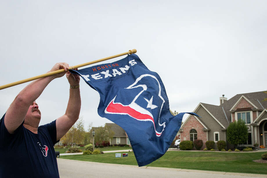 In a community where football allegiances are dominated by the hometown Pewaukee High School Pirates, the University of Wisconsin Badgers and the NFL Green Bay Packers, John Watt displays a Houston Texans flag in support of his son, Houston Texans defensive end J.J. Watt, at his home in Pewaukee,Wis. Photo: Smiley N. Pool, Houston Chronicle / © 2012  Houston Chronicle