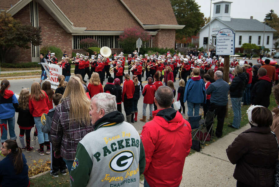 Support for the Green Bay Packers runs deep, as seen in the apparel of residents lining the street as the Pewaukee high school band leads the annual homecoming parade through the streets of Pewaukee,Wis., hometown of Houston Texans defensive end J.J. Watt Photo: Smiley N. Pool, Houston Chronicle / © 2012  Houston Chronicle