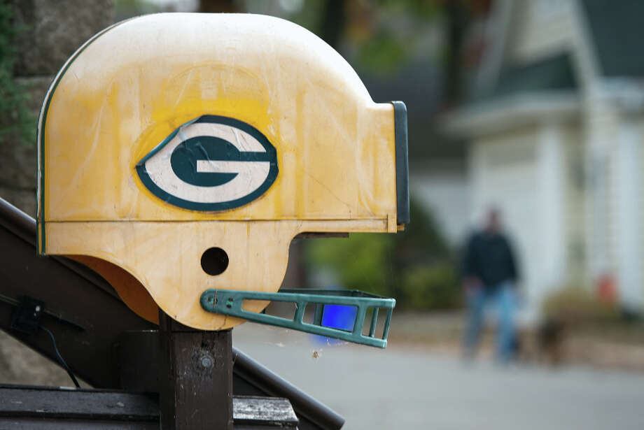 A weathered mailbox in the shape of a Green Bay Packers football helmet is one of the many signs of the loyalty to the NFL team in Pewaukee,Wis. Photo: Smiley N. Pool, Houston Chronicle / © 2012  Houston Chronicle