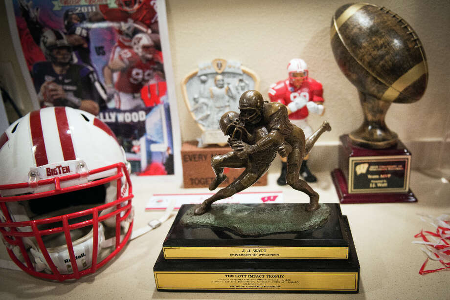 Among the trophies and memorabilia in the basement of the Watt family home in Pewaukee,Wis., the award Houston Texans defensive end J.J. Watt is most proud of, according to his mom Connie, is the Lott Impact Trophy, which is awarded based on character as well as performance. Watt won the award in 2010. Photo: Smiley N. Pool, Houston Chronicle / © 2012  Houston Chronicle