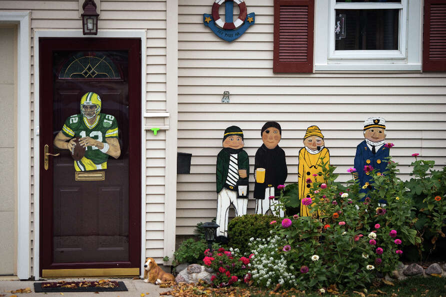 The likeness of Green Bay Packers quarterback Aaron Rodgers displayed on the front door of a home is