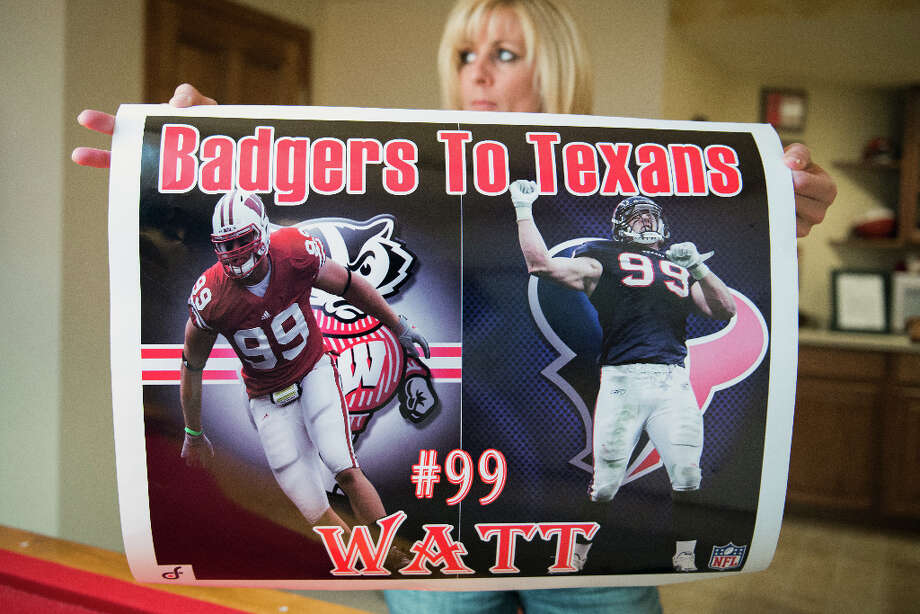 Connie Watt shows off a poster highlighting the college and professional play of her son, Houston Texans defensive end J.J. Watt, at her home in Pewaukee,Wis. Photo: Smiley N. Pool, Houston Chronicle / © 2012  Houston Chronicle