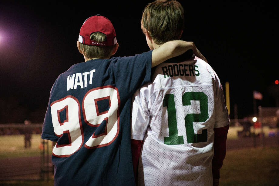 "Luke Lochner, 11, wears a #99 jersey of Houston Texans defensive end J.J. Watt as he poses for a photo with Drew Retherford, 12, who wears the jersey of Green Bay Packers quarterback Aaron Rodgers in Pewaukee,Wis. Loyalties in the community run deep with the Packers, but Watt's starring role has turned many into Texans fans.  When the two teams meet on Oct. 14. Retherford knows who he will be pulling for.  ""I'm wearing a Packers jersey right now,"" he said, ""but when they play, I'll be rooting for the Texans."" Photo: Smiley N. Pool, Houston Chronicle / © 2012  Houston Chronicle"