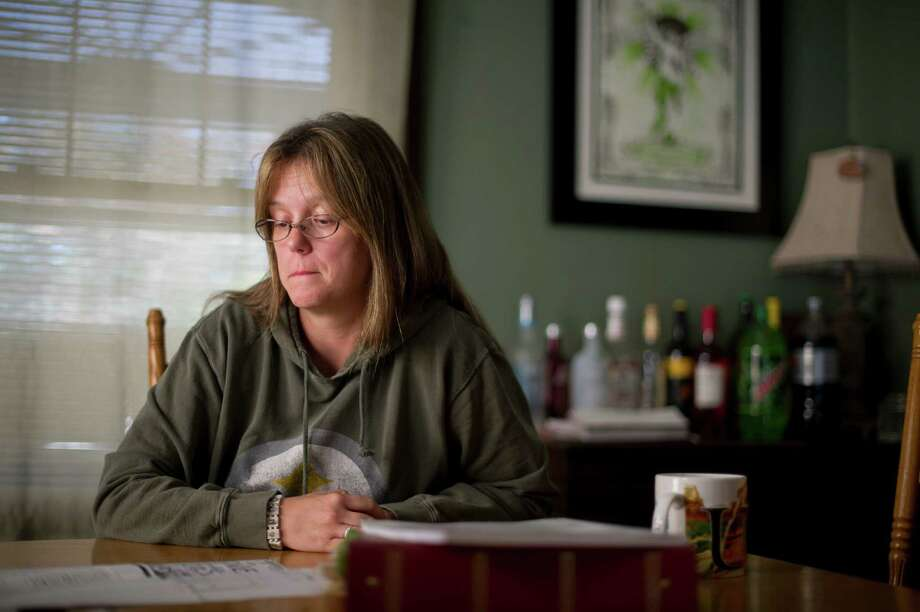 Bobbi Jamriska sits in her home almost 20 years after her sister was murdered by a 15-year-old, who was sentenced to life imprisonment without parole, in Pittsburgh, Oct. 5, 2012. The Supreme Court in June banned mandatory life sentences for juveniles convicted of murder, offering hope to offenders in more than two dozen states while leaving victims' families in turmoil. (Jeff Swensen/The New York Times) Photo: JEFF SWENSEN / NYTNS