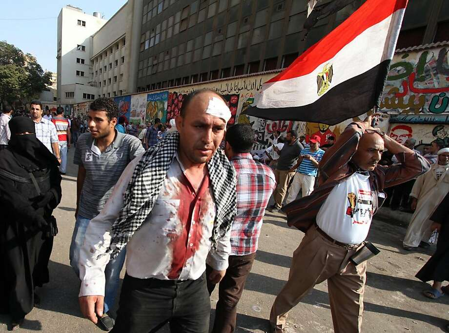 A man is hurt in clashes between government supporters and opponents of the Muslim Brotherhood. A leader of the group has angered Israel with anti-Semitic remarks. Photo: -, AFP/Getty Images