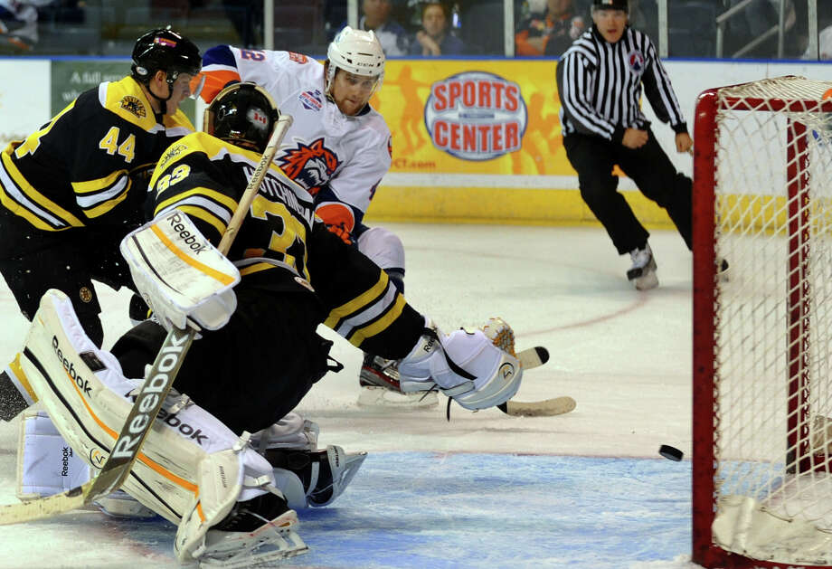 Sound Tigers Brandon DeFazio gets the puck past Providence's goalie Michael Hutchinson, during hockey action at the Webster Bank Arena in Bridgeport, Conn. on Friday October 13, 2012. Photo: Christian Abraham / Connecticut Post