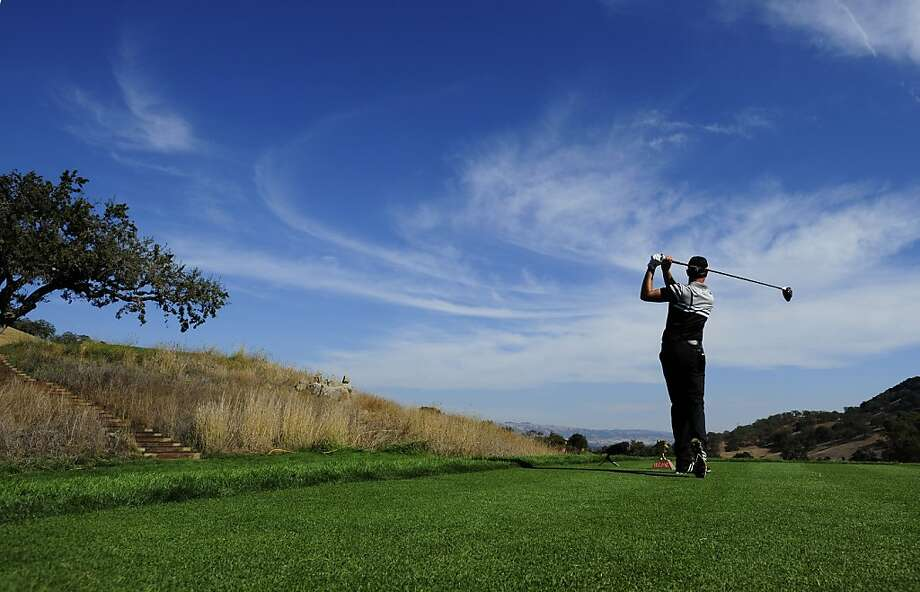 Alexandre Rocha of Brazil, who pulled within four shots of the lead with a 66, tees off on the 18th hole at CordeValle in San Martin. Photo: Robert Laberge, Getty Images