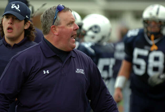 Wilton Head Coach Bruce Cunningham, during boys football action against McMahon in Wilton, Conn. on Friday October 13, 2012. Photo: Christian Abraham / Connecticut Post