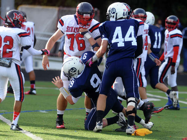 Boys football action btween McMahon and Wilton in Wilton, Conn. on Friday October 13, 2012. Photo: Christian Abraham / Connecticut Post