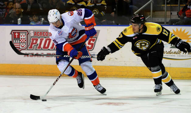 Providence's #17 Chris Bourque blocks an advance to the goal by Sound Tigers #28 John Sundstrom, during hockey action at the Webster Bank Arena in Bridgeport, Conn. on Friday October 13, 2012. Photo: Christian Abraham / Connecticut Post