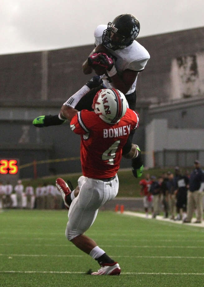 Westside wide receiver Vermaine Newman (top) makes a leaping reception over Lamar defensive back John Bonney during the first half of a high school football game, Saturday, October 13, 2012 at Delmar Stadium in Houston, TX. Photo: Eric Christian Smith, For The Chronicle