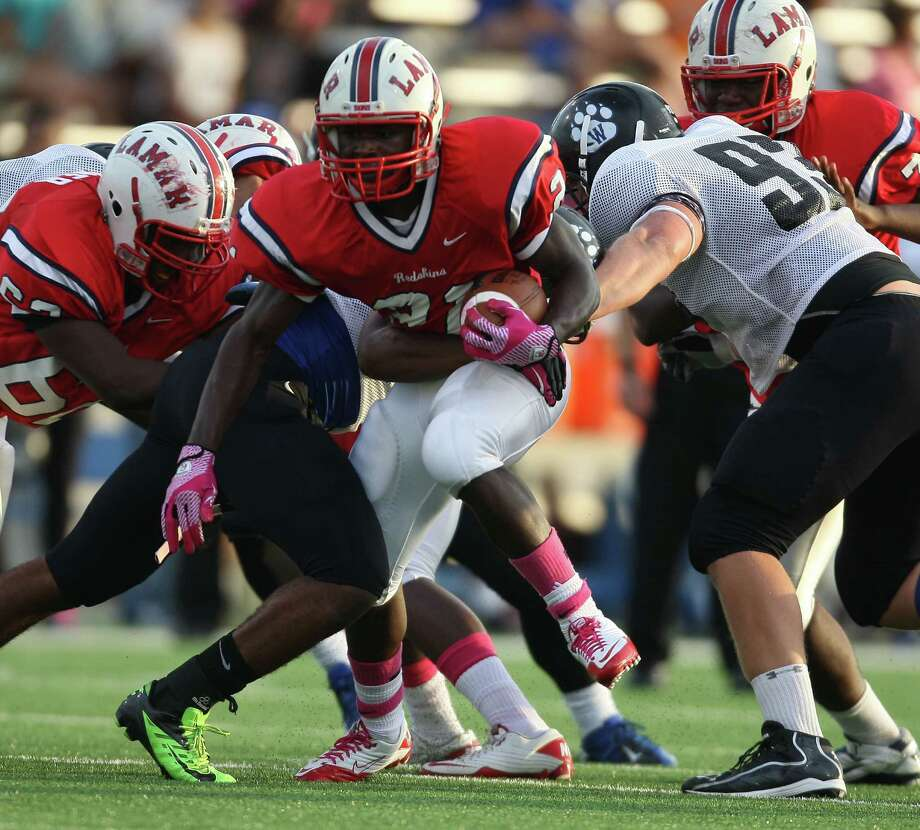 Lamar running back Ronnie Wesley (21) is tackled by Westside linebacker Stephen Holman during the first half of a high school football game, Saturday, October 13, 2012 at Delmar Stadium in Houston, TX. Photo: Eric Christian Smith, For The Chronicle