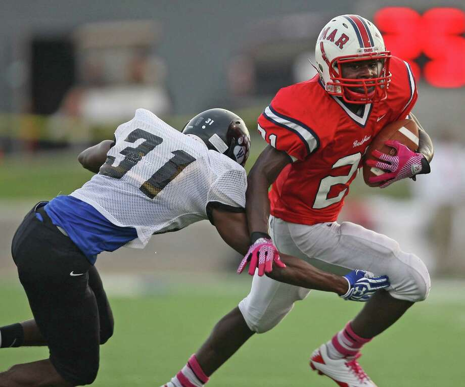 Lamar running back Ronnie Wesley (21) scampers past Westside linebacker Myles Lattin during the first half of a high school football game, Saturday, October 13, 2012 at Delmar Stadium in Houston, TX. Photo: Eric Christian Smith, For The Chronicle