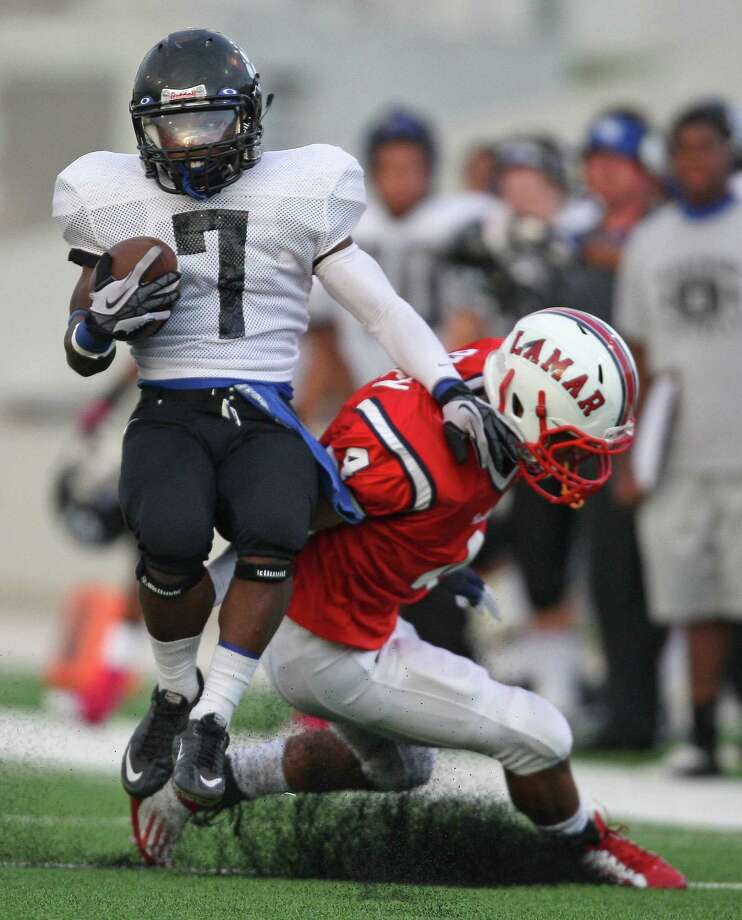 Westside running back Xavier Holman (7) spins past Lamar defensive back John Bonney during the first half of a high school football game, Saturday, October 13, 2012 at Delmar Stadium in Houston, TX. Photo: Eric Christian Smith, For The Chronicle